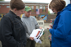 Nancy (right) working with personal branding client Amber Lambke and farmer Justin Tessier at the Skowhegan Farmer's Market. Amber is founder of Maine Grains.